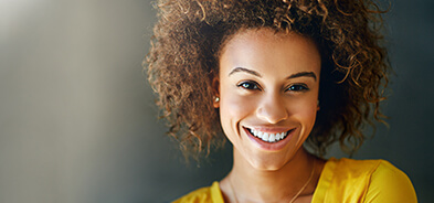 Young woman smiling to show off her bright, white teeth