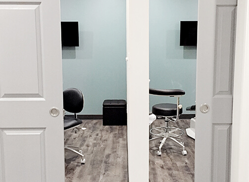 Two private treatment rooms showing TV's and comfortable chairs