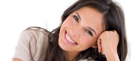 Woman smiling after teeth whitening