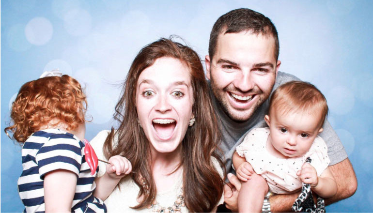 family of four happy to be going to a family dentist
