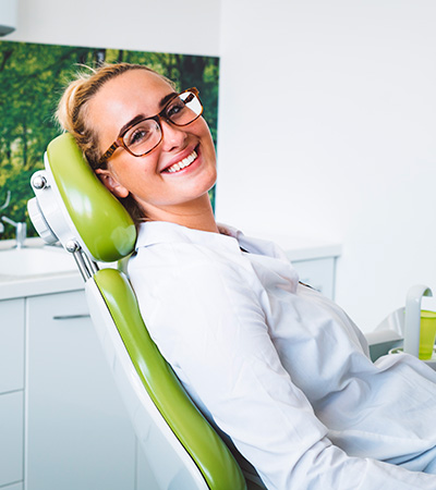 woman in a dental op chair